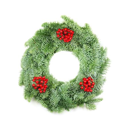 christmas wreath with berries made from real pine boughs isolated on white background photo