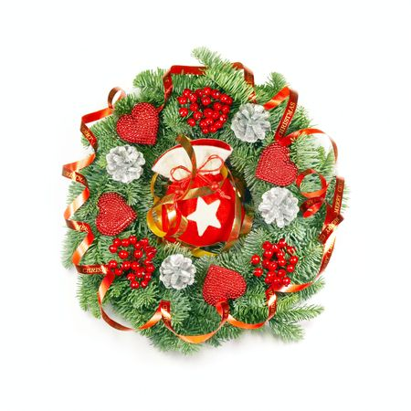 expressive christmas wreath with berries and other ornaments made from real pine boughs isolated on white background photo