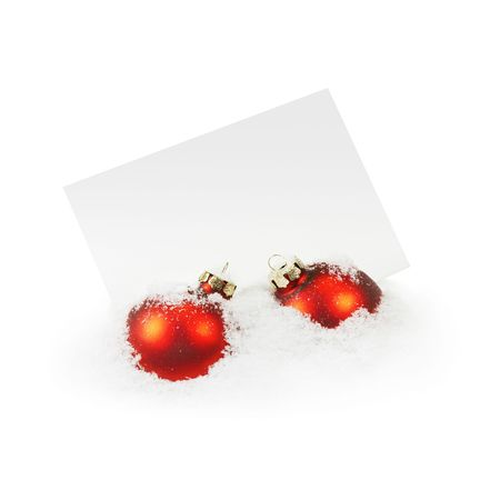 notecard: christmas balls and an empty greeting card on the white snow Stock Photo