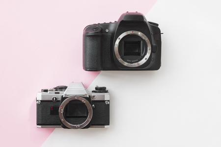 Concept - Digital vs. Analog SLR Camera on Pink Background