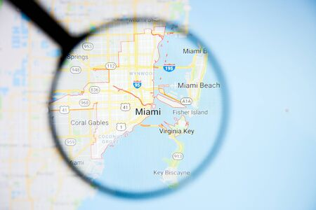 Miami city visualization illustrative concept on display screen through magnifying glass