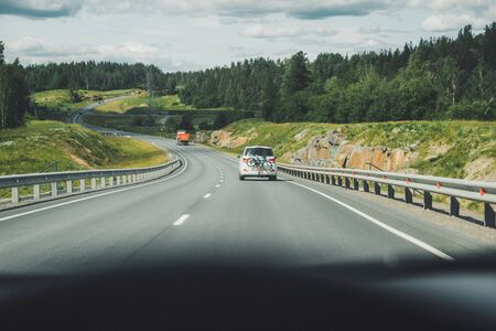 Car driving on winding road for new adventures pov