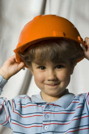 The kid in a building helmet Stock Photo - 3687031