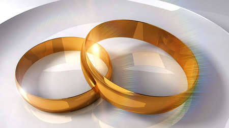constancy: Gold wedding rings on a light background and solar patches of light