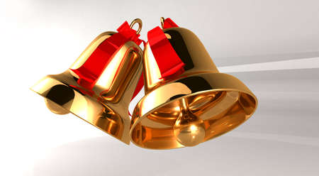 Two gold bell with red ribbons on a light background  photo