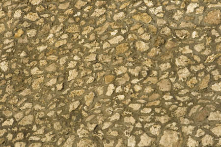 solidity: Abstract background in the form of a stone wall Stock Photo