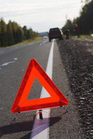 The traffic sign warning about road and transport incident, exposed on a highway roadside photo