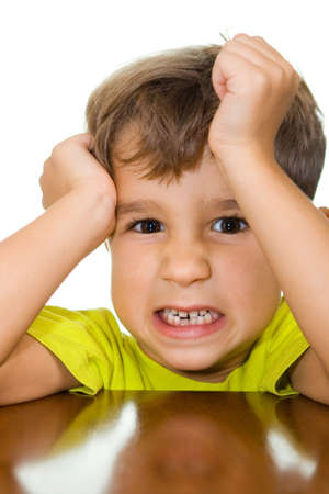 offence: The kid has taken offence and becomes angry about someone Stock Photo