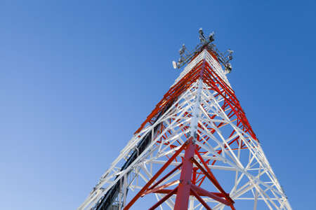 communications tower: Metal design in the form of the aerial for mobile communication with the equipment established on it Stock Photo