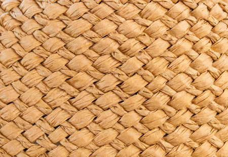 The texture of the weave of straw. Seamless background for design Standard-Bild