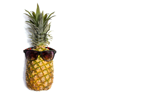 Pineapple isolated. One pineapple in glasses with green leaves isolated on white background Standard-Bild