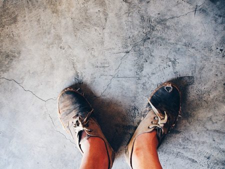 old shoes: Old shoes on the cement floor