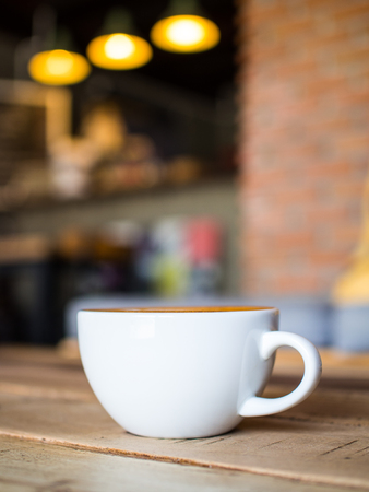 Cup of coffee latte in coffee shop Stock Photo