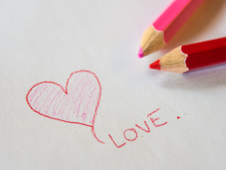 kid drawing: pencil color drawing heart Valentine day Stock Photo