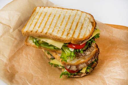 Sandwich with tomato, mozzarella and basil
