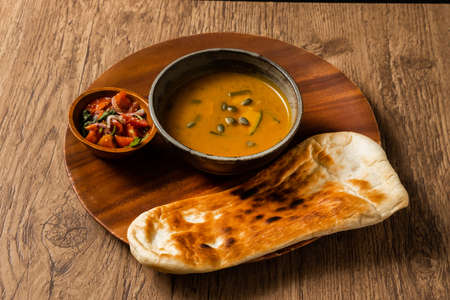 Nan and Indian Curry Naan and Three Colors of India Curry Stock fotó