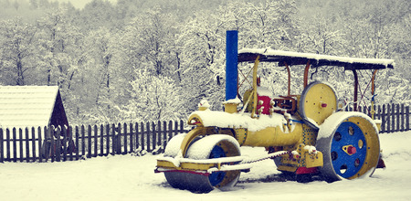 vibroroller: Yellow and Blue Steamroller on a snow