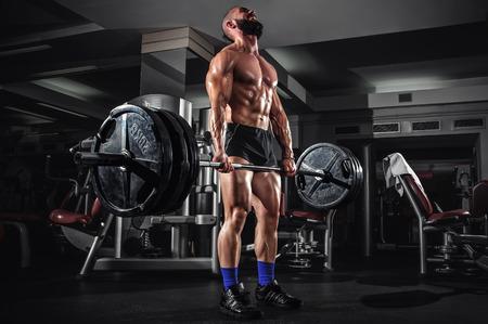 cuerpo hombre: Hombre muscular que hace pesado Peso Muerto Ejercicio