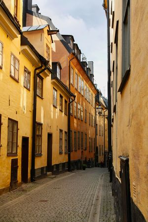 A narrow street in Old Town of Stockholm, Sweden photo