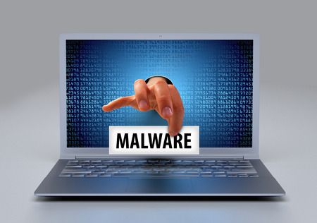stocky: Malware - Ransomwar - virus at a laptop compuer