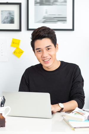 Smart Young Asian Working Stock Photo