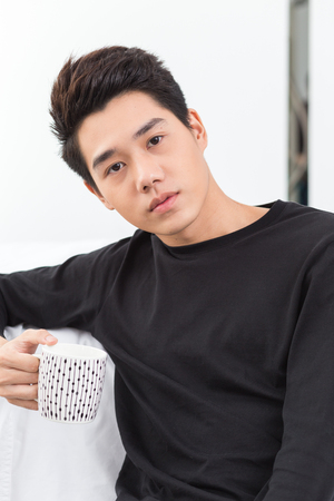 young adult man: Young Asian Coffee Break Stock Photo