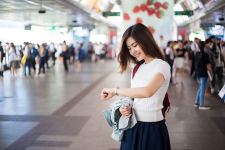 Young Asian lady waiting train Stock Photo