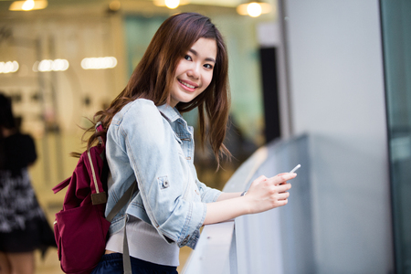 Young Asian lady traveling