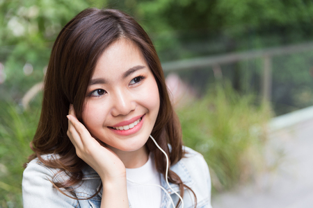 Young asian girl listening music Stock Photo