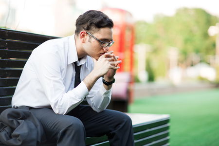 Businessman sitting on the bench