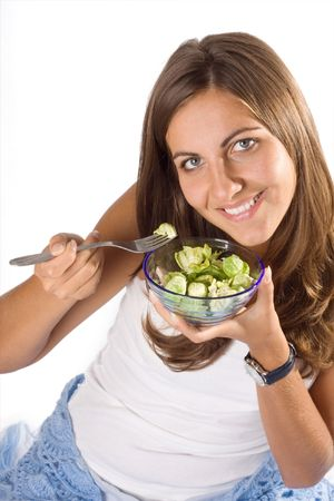 Portrait of young happy smiling woman eating salad Stock Photo - 3806181