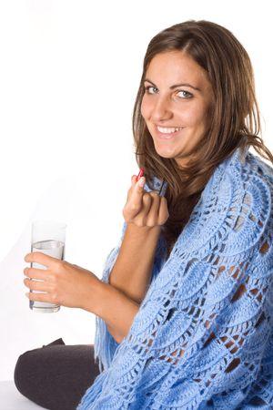 Woman taking pill. Stock Photo - 3844978