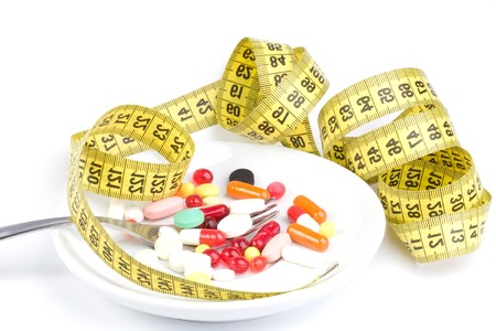 Measure tape with diet pills
