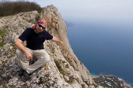 Person climbing sitting on cliff Stock Photo - 4399285