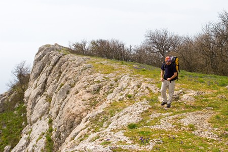 Active people - Person climbing a cliff Stock Photo - 4399732