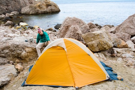 Man near a tent ashore sea Stock Photo - 4399564