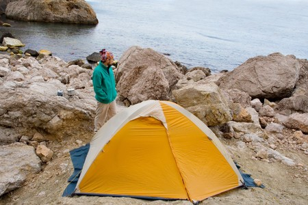 Man near a tent ashore sea Stock Photo - 4399478