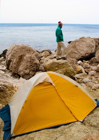 Man near a tent ashore sea Stock Photo - 4399229