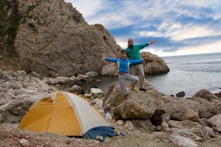 Family near a tent ashore sea Stock Photo - 4399400