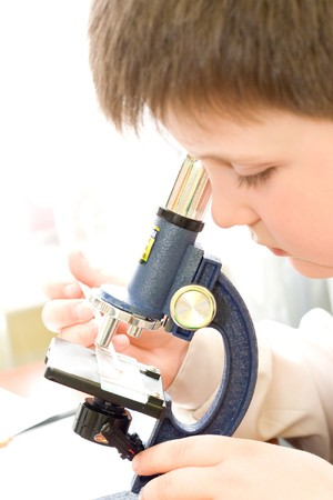 boy with a microscope in a laboratory photo