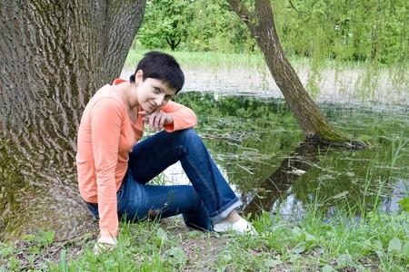 Girl relaxing near a lake photo