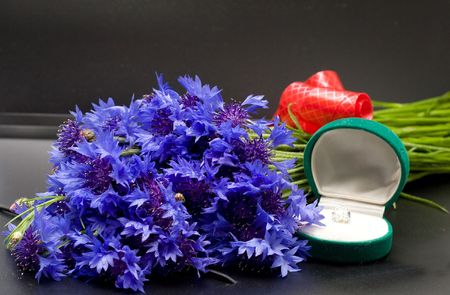 humiliated: wedding rings with bouquet