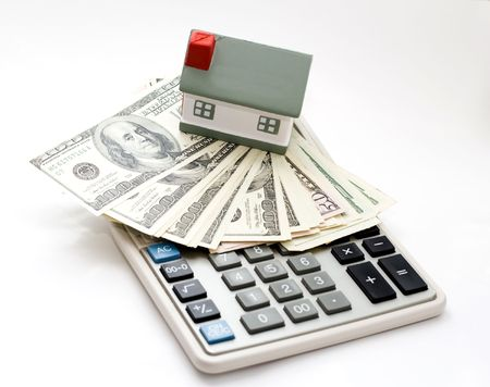 A house on top of a calculator isolated on a white background photo