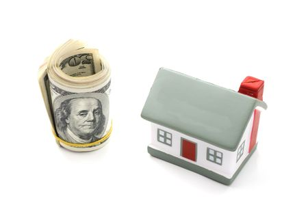 downpayment: house with  dollar bills background Stock Photo