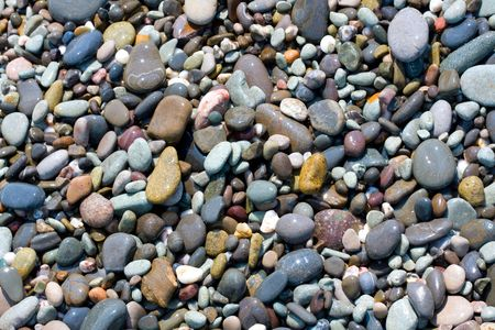 Stone on sea shore photo
