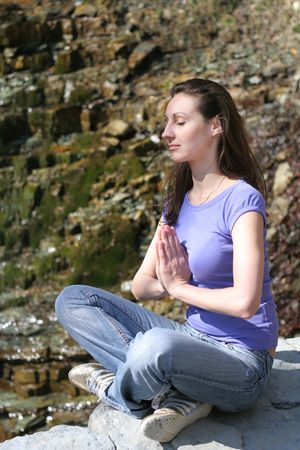 Female doing yogatic exericise in nature Stock Photo - 4767216