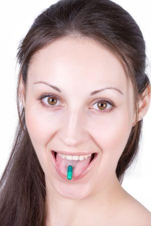 Woman taking pill photo