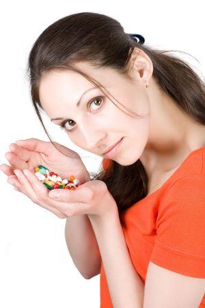 medicaments: Woman taking pill