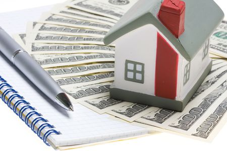escrow: house with dollar bills background