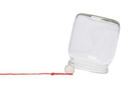 Trap made with coin and glass jar photo